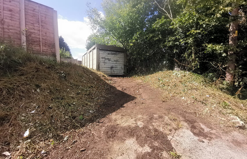 Overgrown bushes and brambles cleared